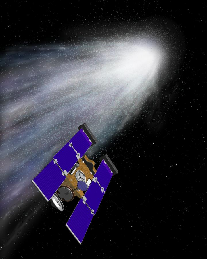Concepção artística da sonda Stardust ('poeira das estrelas') aproximando-se do cometa Wild 2 para atravessar a sua cauda de gás e poeira. A área branca representa o núcleo cometário. A grade coletora é o dispositivo com formato de raquete de tênis que se estende para fora da traseira da espaçonave. Crédito: NASA/JPL