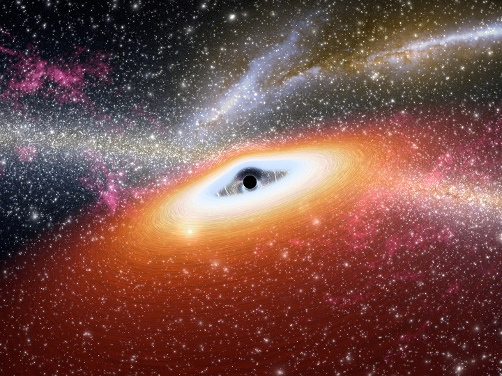 Ilustração de um buraco negro supermassivo (representado pelo ponto negro no coração da galáxia) habitando o centro de uma galáxia ativa. Sptizer revelou detalhes inéditos de duas galáxias ativas primordiais, os quasares J0005-0006 e J0303-0019. O fato incomum que difere estas galáxias ativas das demais é a falta do disco de poeira cósmica central. Crédito: NASA/Photojournal