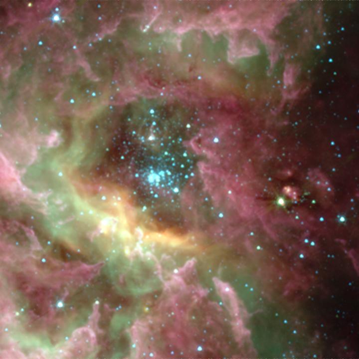 O aglomerado Westerlund 2 e a nebulosa formadora de estrelas RCW 49 no infravermelho pelo Spitzer