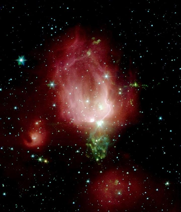 Aqui vemos a NGC 7129 sob as lentes de infravermelho do Spitzer