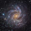 Face a face com a galáxia espiral NGC 6946. Créditos: imagem composta - Subaru Telescope (NAOJ) e Robert Gendler; processamento - Robert Gendler