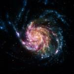 M101: a Galáxia do Cata-Vento em imagem composta através dos quatro observatórios espaciais Chandra, GALEX, Hubble e Spitzer